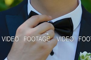 Groom straightens his tie