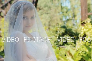 Beautiful bride pose to photographer outdoor