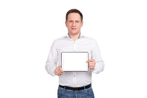 Happy young man showing blank tablet