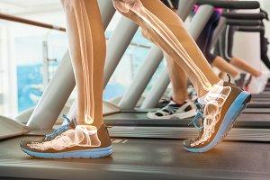 Highlighted bones of man on treadmill