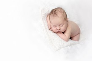 newborn sleep on white knit wool