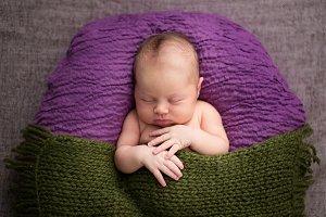 Sleeping newborn, green and purple