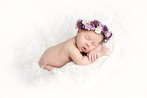 newborn with wreath on white