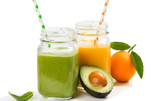Green and orange organic smoothies