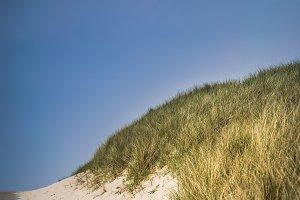Dune in front of blue sky