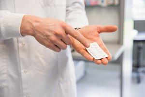 Pharmacist holding medicine blister pack