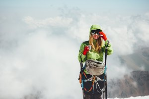 Woman climber drinking tea