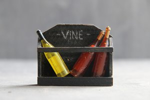 wine storevintage composition, toy bottles and text