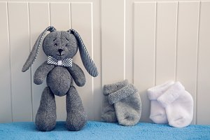 gray toy rabbit standing