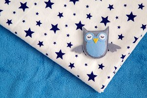 toy owl rests on a child's diaper