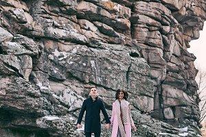 Beautiful couple levitates above the frozen lake