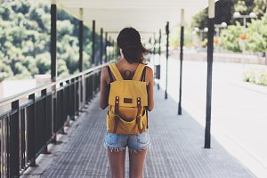 Hipster young girl with backpack