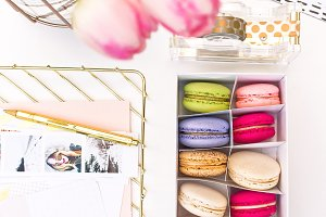 Box of macaroons on desk stock photo