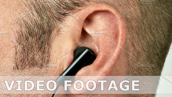Ear With Earphone Vibrating And Jumping To Music