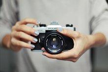 Hands holding vintage camera
