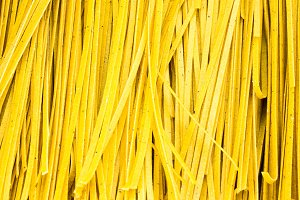 Fresh pasta drying on a rack
