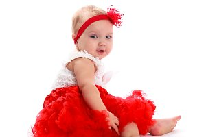 Baby girl in red skirt, white