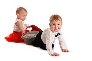 Boy gentleman and baby girl lady