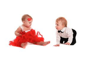 fun couple babies playing with heart
