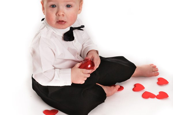 toddler boy with hearts