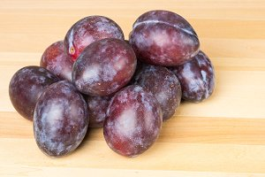 Prune plums on wooden table