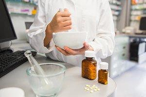 Junior pharmacist mixing a medicine