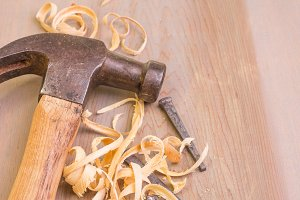 Hammer and wood shavings