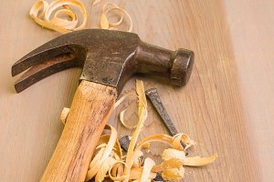 Hammer and nails with sawdust