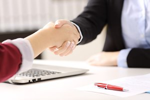 businesswomen hands handshaking
