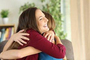 sisters embracing