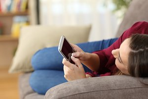 relaxed girl using a smart phone