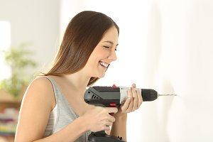 girl using a battery drill