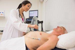 Medical student practicing on older man