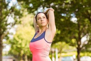 Fit brunette in sportswear stretching