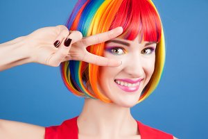 beautiful woman wearing colorful wig