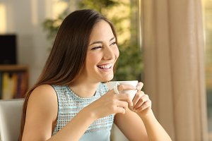 girl holding a mug of coffee