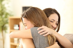 girls embracing at home