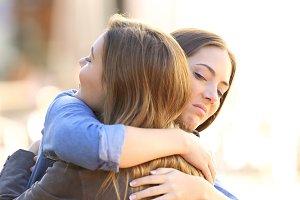 girl embracing a friend
