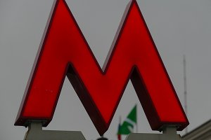The letter M - the subway on the background of the flag