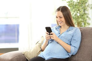 woman texting with a smart phone