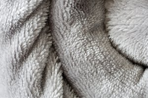 Texture of a rolled up blanket.
