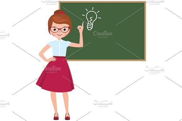 Teacher Standing At The Blackboard