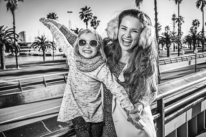 mother and child travellers having fun time in Barcelona
