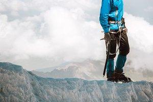 Man climbing on glacier to mountain