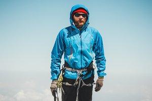 Man climber on mountain summit