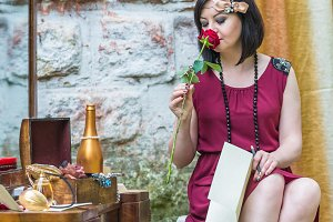 retro woman smells red rose