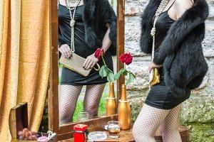 retro woman looks in the mirror