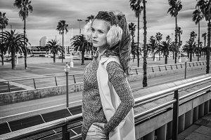 pensive trendy woman in Barcelona, Spain looking into distance