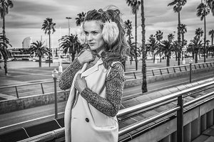 tourist woman on embankment in Barcelona looking into distance