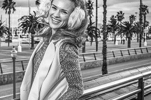 smiling traveller woman on embankment in Barcelona, Spain
